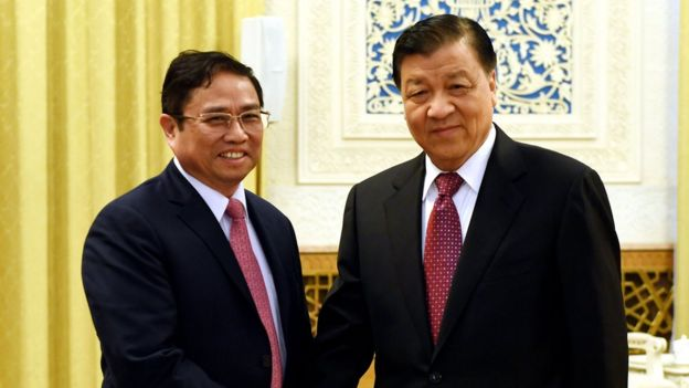 Hai ông Phạm Minh Chính và Lưu Vân Sơn tại Bắc Kinh hôm 12/12