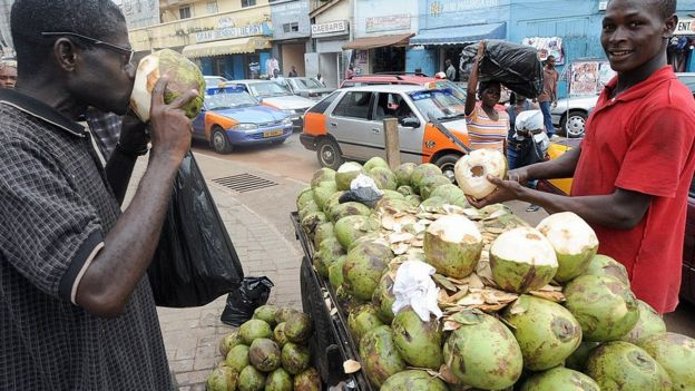 Man drinking coconut water