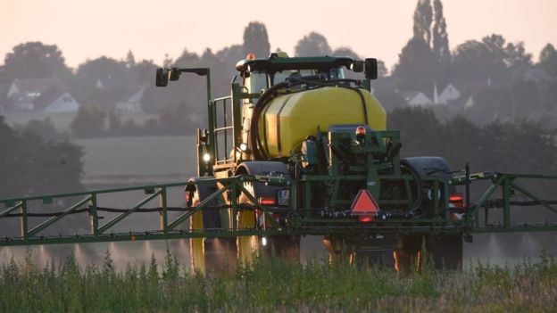 """A French farmer sprays glyphosate herbicide """"Roundup 720"""" made by agrochemical giant Monsanto, in northwestern France, in a field of rye, peas, faba beans, triticals and Bird's-foot trefoil, on September 16, 2019."""