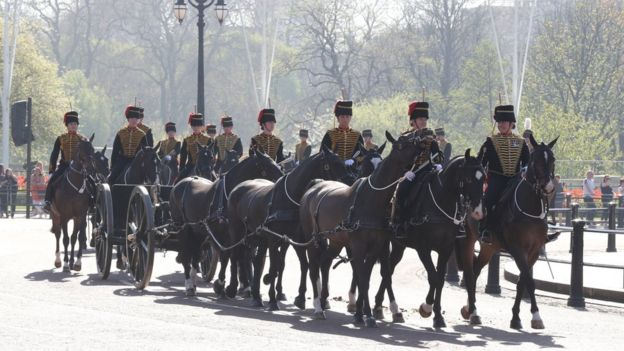 Members of the Kings Troop Royal Horse Artillery ride out in front of Buckingham Palace en route to Green Park