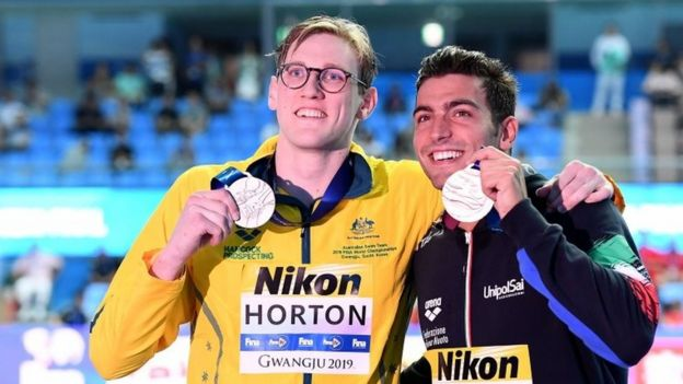 Horton later posed for photos with bronze medallist Gabriele Detti