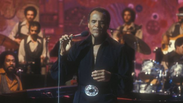 Harry Belafonte performs in 1977