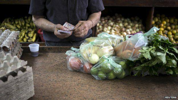 Clerk in Venezuelan shop