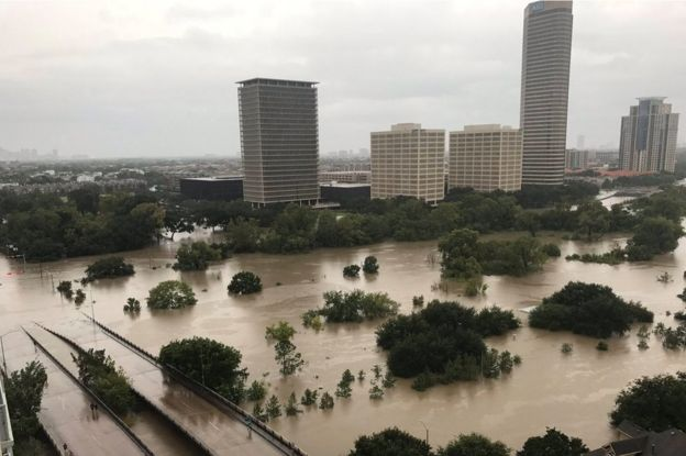 Flooded downtown Houston is seen from a high rise building along Buffalo Bayou