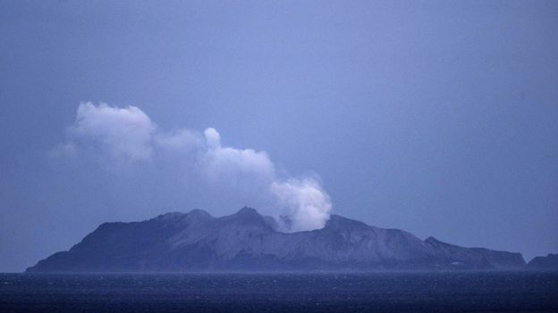 Smoke and ash rises from a volcano on White Island early in the morning on December 9, 2019 in Whakatane, New Zealand