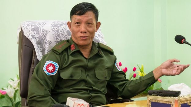Colonel Phone Tint, Rakhine Border Security Minister, seated and dressed in green military fatigues