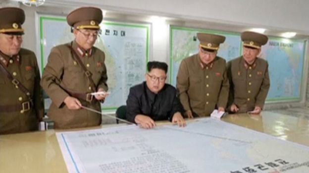 North Korean leader Kim Jong Un reviews the plan for landing missiles near the US territory of Guam (15 August 2017)