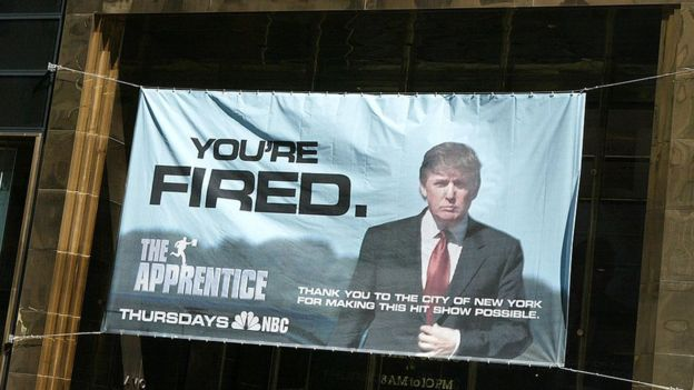 A sign advertising the television show 'The Apprentice' hangs at Trump Towers April 15, 2004 in New York City
