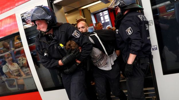 "Police arrest a man on a platform of Friedrichstrasse station after a demonstration of the ""Alternative for Germany"" (AfD) party at the main station in Berlin, Germany, 27 May 2018."