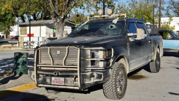 A bullet-riddled pick-up truck is pictured after clashes sparked by suspected cartel gunmen in a northern Mexican town that killed 20 people this weekend, in Villa Union, Coahuila state