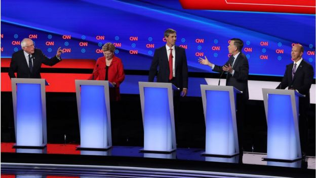 Democratic presidential candidate Sen. Bernie Sanders (I-VT) (L) and former Colorado governor John Hickenlooper (2nd R) speaks while Sen. Elizabeth Warren (D-MA) (2nd L), former Texas congressman Beto O'Rourke and former Maryland congressman John Delaney during the Democratic Presidential Debate