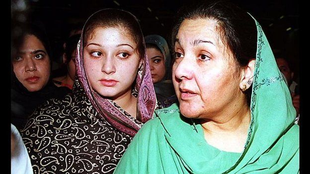 Kulsoom Nawaz, right, wife of deposed prime minister Nawaz Sharif and her two daughters Asma Nawaz, centre, and Maryam Sharif, left, listen to reporters' questions after arriving at Karachi airport on 25 November 1999