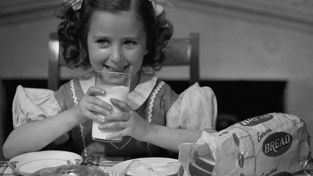 Girl from the 1950s drinking milk.