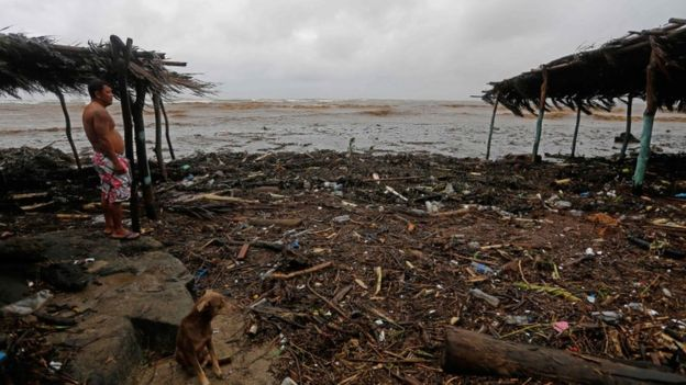 A resident watches the rising waves in Masachapa beach during heavy rains due to Tropical Storm Nate in the city of Masachapa, about 60km from the city of Managua on October 5, 2017