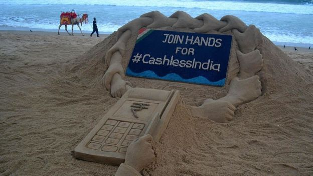 A sand sculpture by sand artist Sudarshan Pattnaik about Cashless India campaign