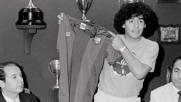 Maradona holding up a Barcelona shirt