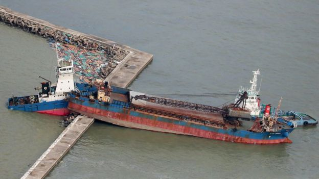 An aerial view from a Jiji Press helicopter shows a ship wedged on a breakwater in Hyogo prefecture