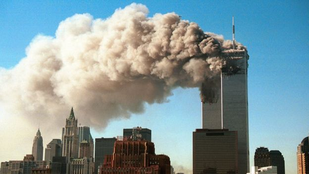 Smoke pours from the World Trade Center in New York after it was hit by two hijacked passenger planes on 11 September, 2001.