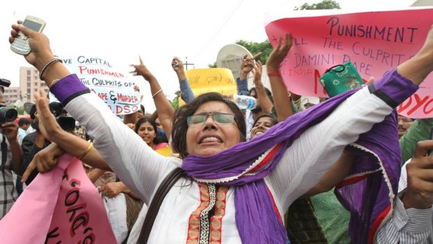 Women shout slogans outside the District court in Saket as they call for the death penalty of the four men convicted of rape and murder on September 13, 2013 in New Delhi, India