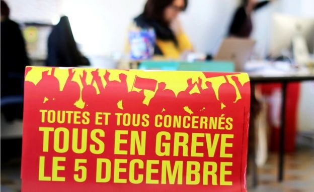 "A poster reads: ""All on strike on 5 December"" - at the Bourse du Travail during preparations for the national strike against the French government's pension reform plans, in Nice"