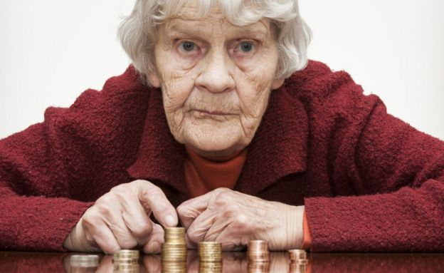 Old lady counting her coins