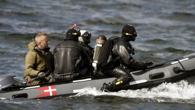 Divers from the Danish Defence Command preparing for a dive in Koge Bugt near Amager in Copenhagen on Tuesday after a woman's torso was found on Monday