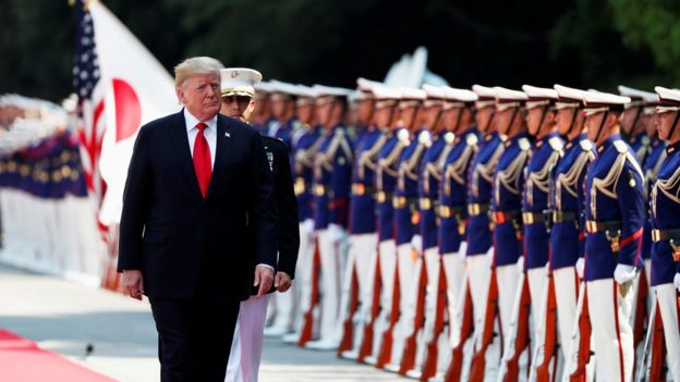 U.S. President Donald Trump reviews an honour guard during a welcome ceremony at the Imperial Palace in Tokyo