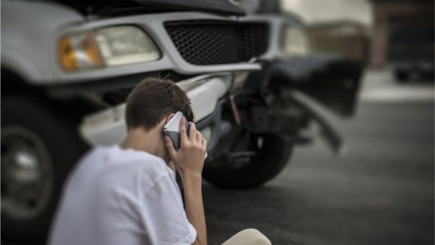 Young man calling by phone after an accident.