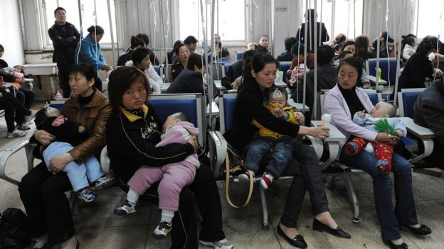 Chinese families accompany their children as they get various injections from flu to rabies shots at a hospital in Hefei,