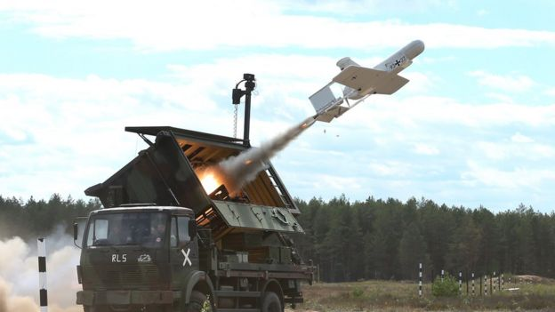 A KZO reconnaissance drone of the Bundeswehr, the German armed forces, launches with the help of a booster rocket during Thunder Storm 2018 multinational Nato military exercises on June 7, 2018 near Pabrade, Lithuania.