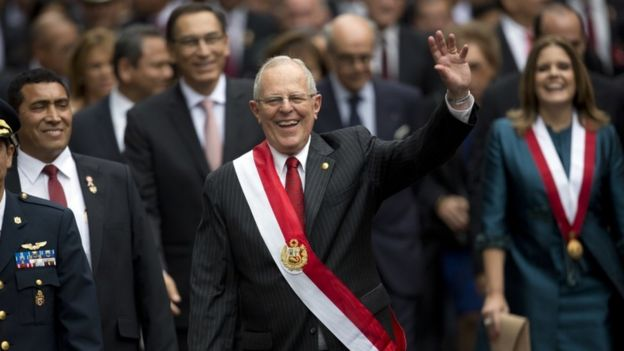 Peru's President Pedro Pablo Kuczynski waves to crowds after being sworn-in