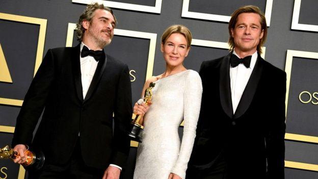 Joaquin Phoenix, Renee Zellweger and Brad Pitt with their statuettes