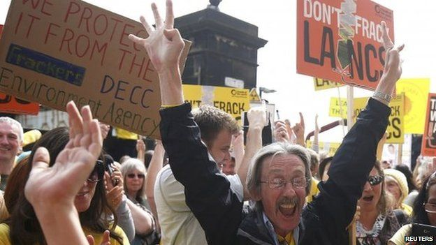 Anti-fracking protesters celebrate outside County Hall in Preston