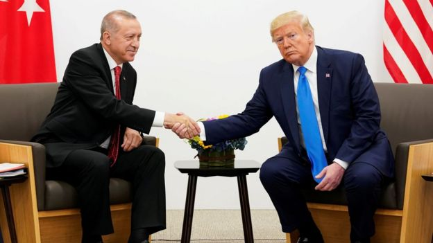 File photo showing Turkish President Recep Tayyip Erdogan shaking hands with US President Donald Trump at the G20 summit in Osaka, Japan (29 June 2019)
