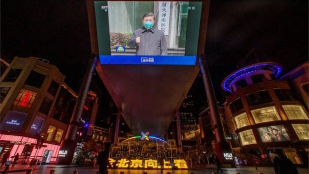President Xi in Wuhan in March, as shown on a public screen in Beijing