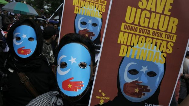 Protesters, who are members of the Muslim Solidarity Movement, hold placards during a protest against violence and the treatment of Uighur Muslims by the Chinese government, in Bandung, West Java, Indonesia, December 21, 2018