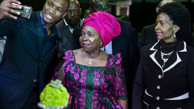 A guest takes a selfie with Nkosazana Dlamini-Zuma during a presidential Gala dinner at the Nasrec Expo Centre in Johannesburg on December 15, 2017