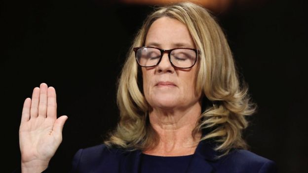 "Christine Blasey Ford closes her eyes as she is sworn in before testifying to the Senate Judiciary Committee confirmation hearing for President Donald Trump""s Supreme Court nominee Judge Brett Kavanaugh on Capitol Hill in Washington, U.S., September 27, 2018."