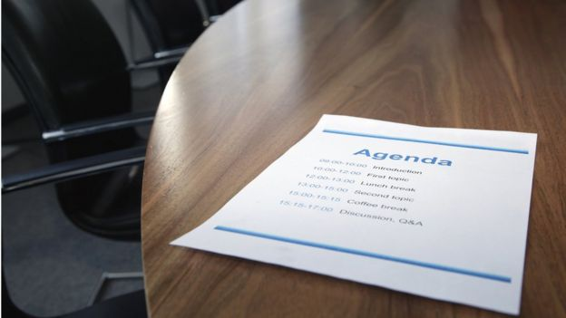 Table with agenda print out