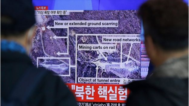People look at a screen showing news of the nuclear test, outside a train station in Seoul