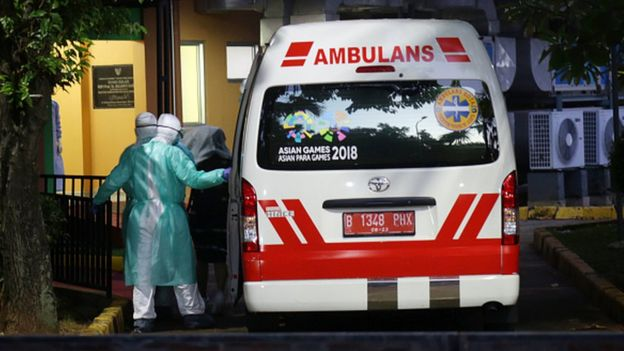 An ambulance arrives with patients at Sulianti Saroso Hospital in Jakarta
