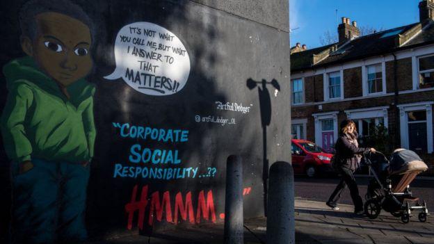 Critical graffiti with H & M.