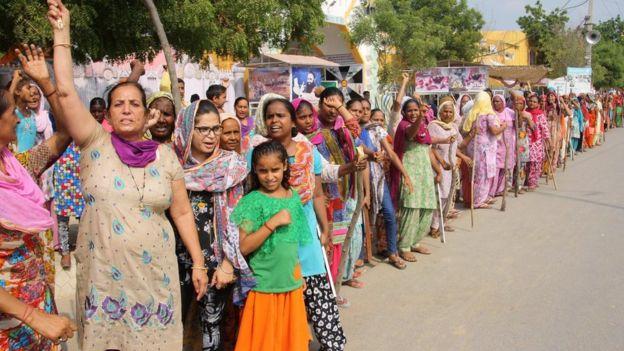 Women supporters ahead of the verdict