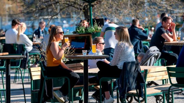 People sitting outside drinking in a bar in Sweden