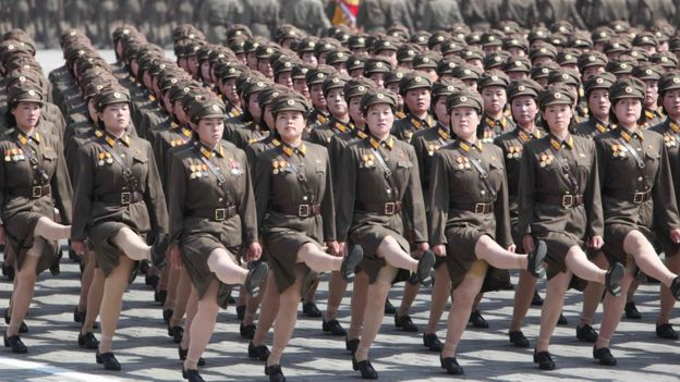 Row of marching female soldiers in skirts
