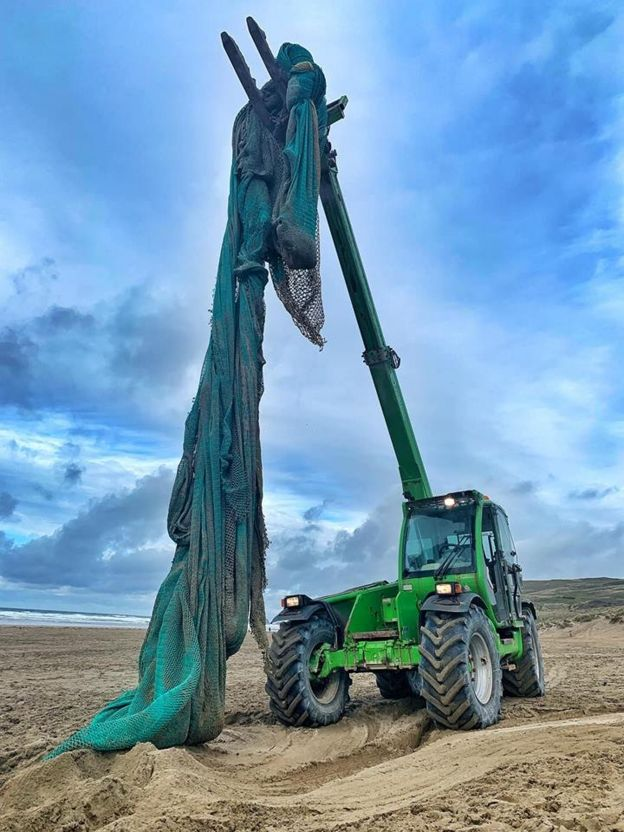 ghost net being lifted by tractor