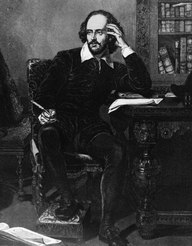 William Shakespeare (1564 - 1616) at his desk circa 1600