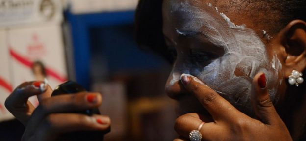 A beautician who works on Nairobi's River Road illustrates how to apply skin-lightening cream