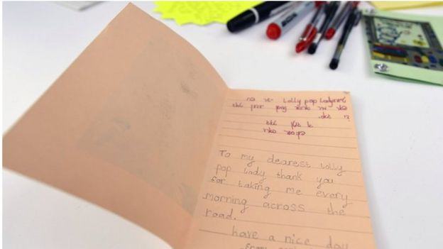 Child writes message to their lollipop lady