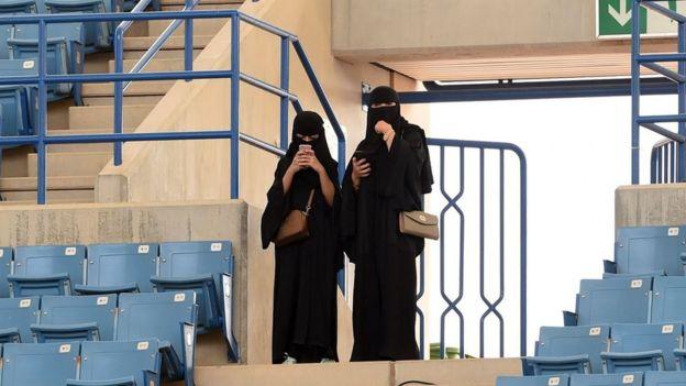 Two women in a stadium in Riyadh.